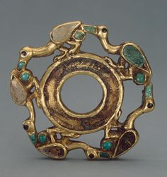 Coiled Arm Decoration. Epoch. Period: Early Iron Age. Date: Sakae Culture. 5th - 4th century BC. Place of finding: Siberian collection of Peter I. Archaeological site: Russia, Siberia. Material: gold, turquoise, corals and black stone Technique: cast and soldered.