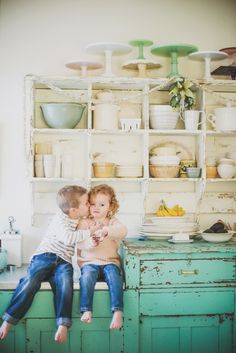 Pure love. Open shelves & repainted re-purposed cabinets in the kitchen help conserve living hardwood trees for our next generation.