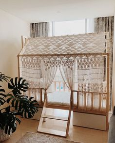 Macrame playhouse knot and fringe construction with drape doors and windows