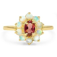 The Wan Ring, top view. A floral halo of opals surrounds an oval-shaped garnet set in 14K yellow gold creates an ethereal look on this Retro-era engagement ring (Garnet approx. 0.45 total carat weight).