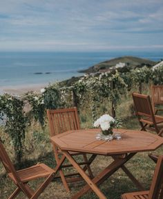 Teak furniture is great for adding an outdoor chillin' space at a marquee wedding, especially if the view is this good! Wedding Ceremony Marquee, Wedding Table Seating, Wedding Table Flowers, Marquee Hire, Marquee Lights, Folly Farm, Flower Table Decorations, Wooden Folding Chairs, Vintage Bunting