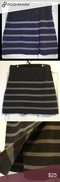 "LOFT - Super Cute Sweater Skirt - MP This beautiful black with gray horizontal stripes sweater skirt is in great condition! Adorned with 6 buttons, it has a small split in the front for a comfortable fit! Elastic waist band. Measured laying flat: 15"" waist and 17"" inseam.  51% Acrylic & 49% Wool LOFT Skirts"