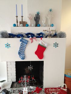 My current cover photo on the social networking Web sites: Lynn Friedman, Xmas & Hanukkah Together Fireplace Decoration, San Francisco, 29 Dec. 2011, under a Creative Commons license. #Hanukkah #Chanukah #Yule #Chrismukkah #lynnrfriedman #SanFrancisco #fireplace #FireplaceMantel #ChristmasStocking #menorah #ChristmasOrnament