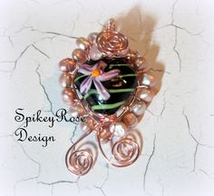 Gorgeous handcrafted little lampwork heart wirewrapped in rose gold wire with little seed pearls