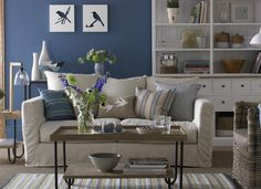 Blue living room with white linen sofa