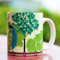 Tamara Peacock Dawn Mug : This Tamara Mug features two peacocks lounging about, high up in the canopy as the new day begins.