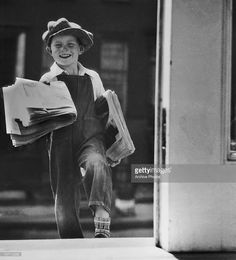 A young newspaper delivery boy circa 1940's.