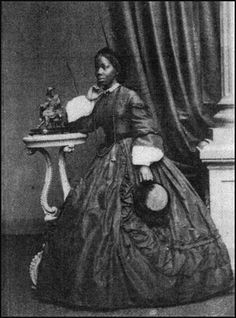 "A portrait of  Miss Sarah Forbes Bonetta, the ""African Princess"". A carte-de-visite portrait taken at Merrick & Co.'s photographic studio at 33 Western Road, Brighton, before her marriage to James Labulo Davies in 1862."