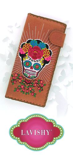 Designed by PETA approved vegan brand LAVISHY, this large flat wallet features colorful Frida style sugar skull embroidery motif. Made with Eco-friendly vegan materials that are toxic-free, recyclable and biodegradable (tested by SGS).  Exterior: Vegan/faux leather Interior: Nylon - 1 photo ID pocket - 11 card slots - 1 built-in zipper pocket for change or receipts - 4 inside long slots for cash or a checkbook - Snap closure enables easy open and close Wholesale available at www.lavishy.com Corolla Flower, Mexican Artists, Embroidery Motifs, Leather Interior, Wallets For Women, Sugar Skull, Biodegradable Products, Eco Friendly, Fashion Accessories