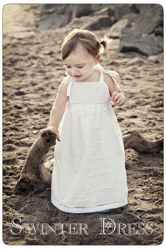 This sundress is also cute, I like the use of the white fabric, the straight edge to the bodice, and the ribbon ties.  Not as good of a tutorial, but can probably manage this using techniques in other tutorials.