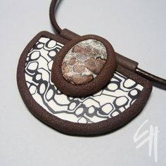 Polymer clay jewellery - pendant. Combined with mineral.