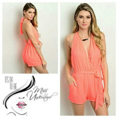 Coral Romper Halter style romper in a beautiful shade of vibrant neon coral and comes with a tie sash. Made of 100% Polyester and comes  in sizes Small & Medium.  **PLEASE DO NOT PURCHASE THIS LISTING JUST COMMENT BELOW ON WHICH SIZE YOU WOULD LIKE AND I WILL CREATE A LISTING JUST FOR YOU** PRICE IS FIRM UNLESS BUNDLED MissUnderstood Boutique Pants Jumpsuits & Rompers