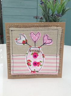 Hello there, thank you for looking in my shop.. This listing is for this very lovely brown recycled card with a vase of heart shaped flowers machine embroidered on.. I have made it using brown recycled card with burlap, linen, French ticking and pink buttons stitched on.. This card