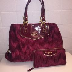 Coach purse and wallet Coach Ashley gathered sateen matching purse and wallet in deep red color. Excellent condition; has been used however like new. Purse has zippered section in middle as well as two pockets. Coach Bags Shoulder Bags