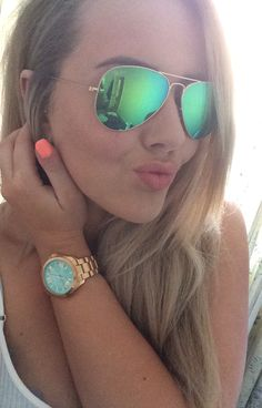 Green mirror ray bans. Fossil mint and rose gold watch. Beach bag nail varnish by models own.