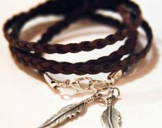 Brown braided flat leather wrap bracelet with 2 silver feather charms