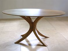 oval table by by SixNineThree