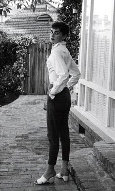 Rare Audrey Hepburn — Audrey Hepburn poses outside her Beverly Hills... -----loose sleeves tight bodice