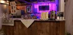 Drink despencers with signs and material with pictures and candles sitting on the bar