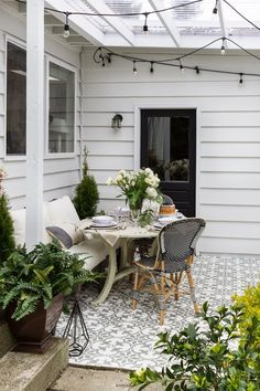 Outdoor Covered Living Space with Grandin Road. Farmhouse, Eclectic Modern Style decor.