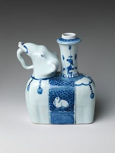 Elephant-Shaped Kendi Drinking Vessel Period: Ming dynasty (1368–1644) Date: late 16th century Culture: China Medium: Porcelain painted in underglaze blue Dimensions: H. to top of spout 7 in. (17.8 cm); L. 6 1/2 in. (16.5 cm) Classification: Ceramics Credit Line: Purchase, Seymour Fund, funds from various donors and Stanley Herzman Gift, 2003 Accession Number: 2003.232