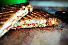 eating this tonight. grilled chicken & roasted red pepper paninis. except i could only find yellow peppers. and then after roasting them, i forgot to put them on my panini. so, i guess it is just a grilled chicken panini. but the sundried tomato pesto is yummo.