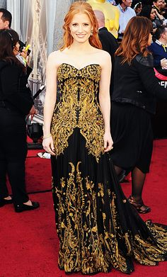 Best Supporting Actress nominee Jessica Chastain walked the red carpet in a black Alexander McQueen gown with an intricate gold overlay and a flowing chiffon train.