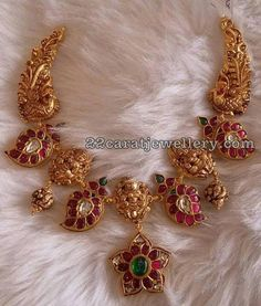 22 carat gold nakshi work Lakshmi and kundan mango clasps combination short necklace with ruby emerald flower motif attached at the bottom