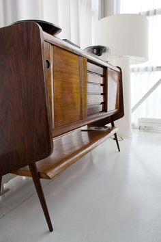 Mid Century Scandinavian Modernism. Our record/stereo console for tv stand in living room.