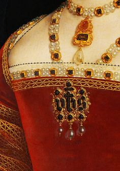"Detail of Holbein's painting of Jane Seymour. Jane wears what seems to be the ""queen consort's necklace."" Most of Henry's queens are painted wearing it. She also wears Katharine of Aragon's ""IHS"" pin on her bodice. What did these queens all feel when they stepped into the furs, clothes and jewelry of their predecessors?"