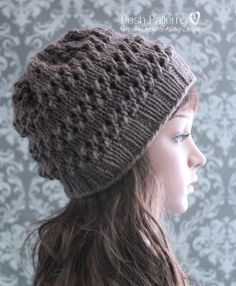38e9dfa8d2e This cute knit hat pattern features an eyelet lace stitch design. A little  slouchy