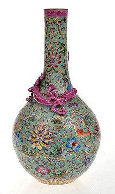 ELABORATE AND HEAVILY ENAMELLED CHINESE TURQUOISE GROUND FAMILLE ROSE BOTTLE VASE WITH APPILED DRAGON, FOUR CHARACTER SEAL MARK TO BASE, 26.5CM HIGH
