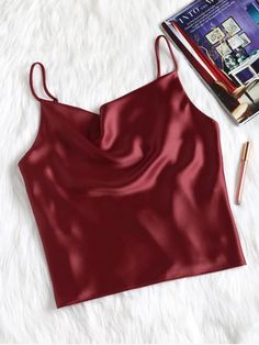 So comfy and easy to wear, this cami tank features in a faux satin, silky fabric with adjustable spaghetti straps in an oversized fit. Look good by pairing it with all of your denims for an effortlessly casual look. Satin Tank Top, Cami Crop Top, Lace Tank, Cropped Tank Top, Cami Tops, Satin Shirt, Red Satin Top, Satin Cami, Cute Tank Tops
