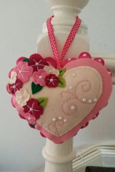 Looking for the wow factor? This gorgeous large hanging felt heart decoration will add wow to any home, guaranteed! Made from felt and finished with flowers, embroidery and half pearls it certainly stands out! Shown here in various sh. Felt Embroidery, Felt Applique, Felt Christmas Ornaments, Christmas Crafts, Fabric Crafts, Diy Crafts, Felt Decorations, Heart Crafts, Valentine Day Crafts