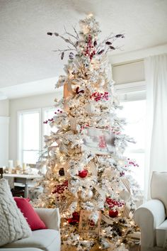 To achieve this snow-dusted effect, sprinkle your tree with snow flock.  Get the tutorial at Ella Claire Inspired.  - WomansDay.com