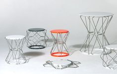 """The MOTION collection by ANNE BOENISCH consists of a folding stool and table that utilize stainless steel bolts in the frame and seat, allowing the piece to be """"stretched and squeezed"""" horizontally. I love that it can be flattened when not in use."""