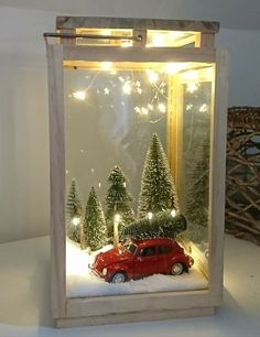 Unique DIY Christmas Lantern Decoration Ideas / Inspo - Hike n Dip Here are unique DIY Christmas Lantern Decor Ideas. These Christmas Lantern Decor with Ornaments, Ribbons & Christmas Village scene are really very beautiful Lantern Christmas Decor, Diy Christmas Decorations, Noel Christmas, Christmas Projects, Christmas Themes, Holiday Crafts, Christmas Ornaments, Holiday Decor, Lantern Diy