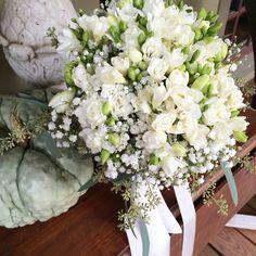 Romantic white freesia bridal bouquet.