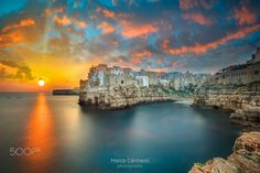 """Sunrise in Polignano a Mare - Polignano a Mare is a town and comune in the Metropolitan City of Bari, Apulia, southern Italy, located on the Adriatic Sea. The local economy mostly depends on tourism, agriculture and fishing. Follow me on <a href=""""https://www.facebook.com/carmassi.marco""""> Facebook</a> for more informations: marcocarmassiphotographer@gmail.com"""