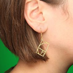 ThinkGeek.com...Golden Ratio Earrings - A 2D representation of the Golden Spiral, in, cleverly enough, gold. $33