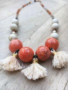 Finola Jewelry || BRII // GOLD BOHO TASSEL NECKLACE   $158.00   Handmade Tassels   Ceramic & Moonstone Beads   Swarovski Crystals   Durable Gold Filled Clasp   1″ Extender Chain
