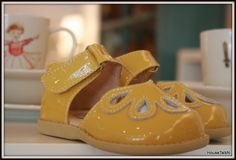 Check out these sweet yellow baby shoes!