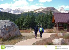 Photo about An image of two women setting off from a state park to go hiking in the high mountain landscape of Arapaho & Roosevelt National Forests. Image of clear, mountains, cover - 103382399 Mountain Images, Go Hiking, Mountain Landscape, National Forest, Rocky Mountains, State Parks, To Go, Editorial, Travel