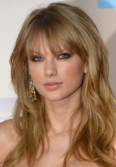 Taylor's bangs are always perfect..I still can't get over how gorgeous she was at the American music awards last year..