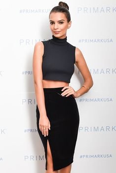 Slit pencil skirt with a turtleneck crop top and top knot.