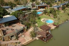 The Silver Streams Lodge and Day Spa lies within the magnificent bushveld near Bela Bela, Warmbaths, in South Africa's northern Limpopo Province. This unique lodge offers the ideal getaway for leisure and conference guests, with natural surroundings. Spa Day, Aerial View, Lodges, South Africa, Mansions, House Styles, Nature, Silver, Africa