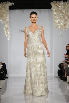 Pnini Tornai makes the best dresses! They're so elegant and have so much detail!! I love all the beads and crystals!!