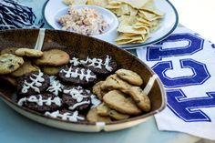 tailgate desserts including homemade football brownies and peanut butter chocolate chip cookies (crowd favorites) Tailgate Desserts, Tailgate Food, Football Brownies, Football Food, Pretzel Factory, Veggie Tray, Football Season, Serving Dishes