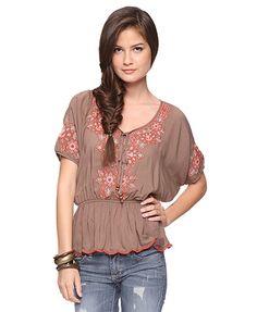 Really cute, earthy tones. love the shirt and hair