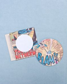 The bride and groom gave guests CDs, which doubled as place cards at the tables. Because the bride and groom love music so much, it was an obvious choice to pick a CD compilation as their favor. Each sleeve was made by hand by the duo from actual comic book pages, so each one was unique.